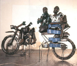 Douglas-Camp, Sokari * 1958 'Bike 2000', 2000 2 teilig: 160x80x136 cm, 140x75x186 cm Steel, Electric Motors, Perspex Besitz der Künstlerin